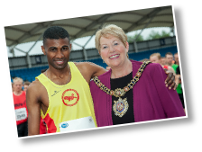 The Lord Mayor of Manchester meets last year's winner at the We Love Manchester 10K